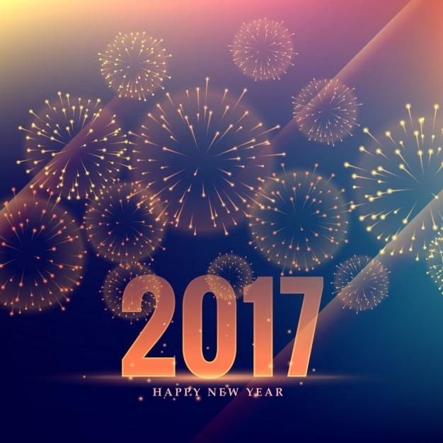 Elegant golden background of 2017 with fireworks Free Vector