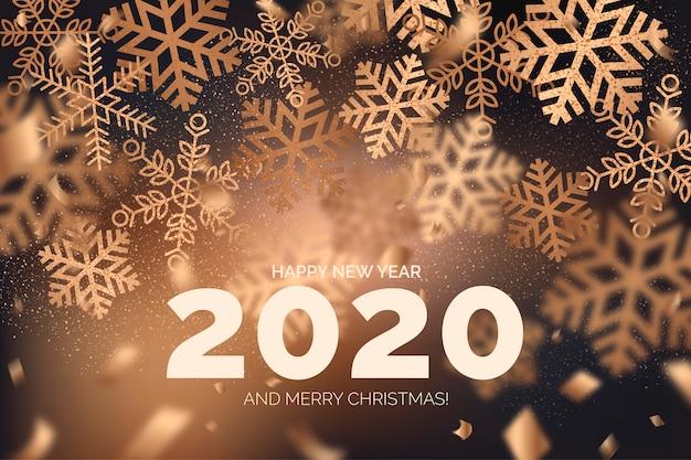 Elegante sfondo di felice anno nuovo con fiocchi di neve Vettore gratuito