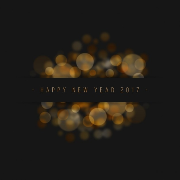 elegant new year background with bokeh effect free vector