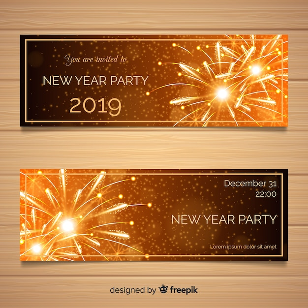 Elegant new year party banners with realistic design Free Vector