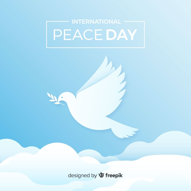 Elegant peace day background with white dove Free Vector