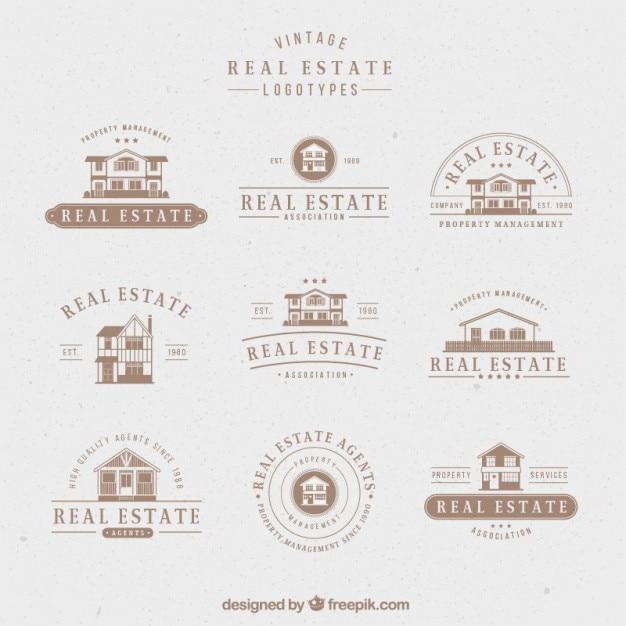 Elegant real estate logos in retro style Free Vector