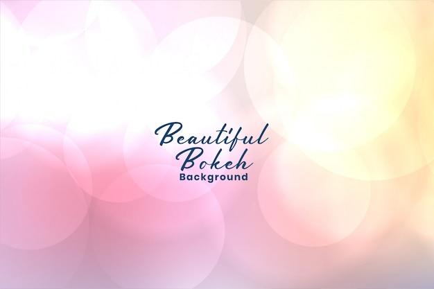 Elegant soft pink blurred bokeh background Free Vector