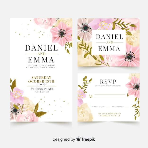 Elegant wedding card template with realistic flowers Free Vector