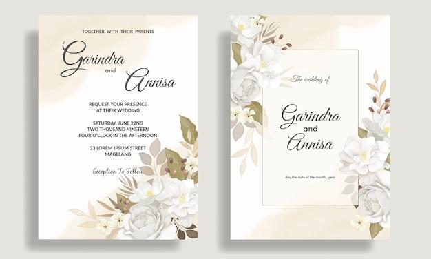 美しい白い花と葉で設定されたエレガントな結婚式の招待カードテンプレート Premiumベクター