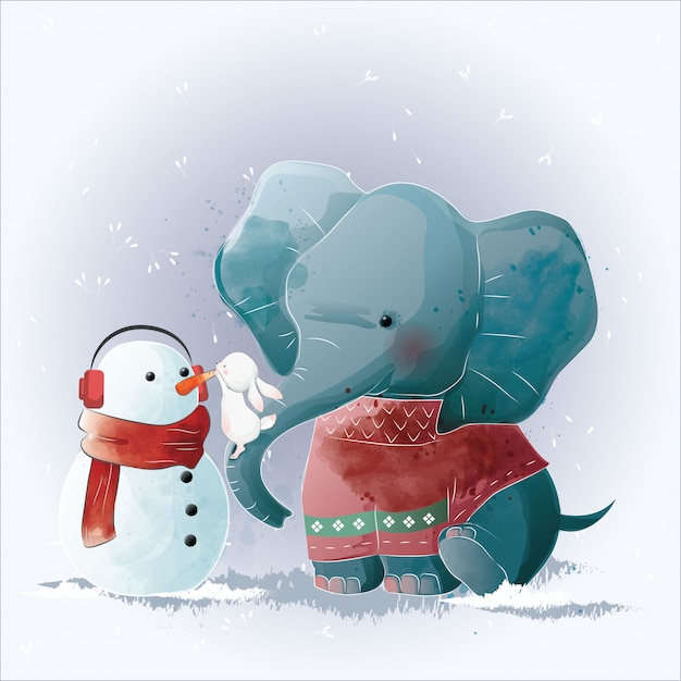 Elephant and bunny building a snowman Premium Vector