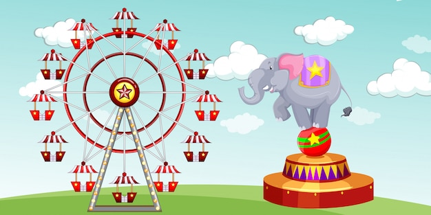 Elephant show and ferris wheel at the funpark Free Vector