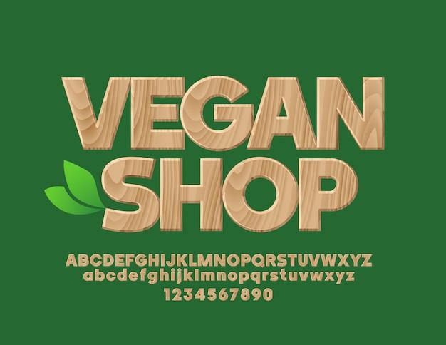 Эмблема с текстом веганский магазин деревянный текстурированный шрифт био шаблон дерева алфавит, буквы и цифры Premium векторы