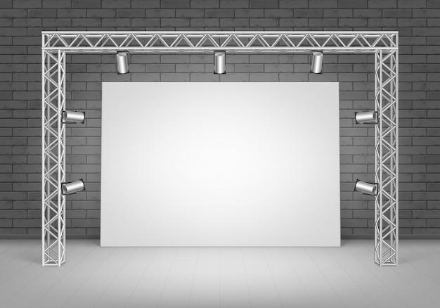 검은 벽돌 벽 및 스포트 라이트 조명 전면보기와 함께 바닥에 서있는 빈 빈 흰색 포스터 그림 프리미엄 벡터