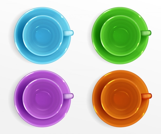 Empty color cups for coffee and tea top view Free Vector