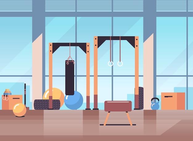 Пустой нет людей спорт тренажерный зал интерьер оборудование для тренировок фитнес обучение концепция здорового образа жизни Premium векторы