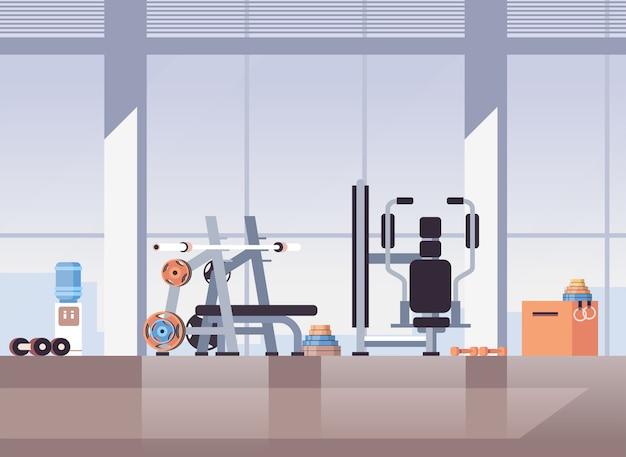 Пустой нет людей спорт тренажерный зал интерьер тренажеры оборудование тренажеры фитнес концепция здорового образа жизни Premium векторы