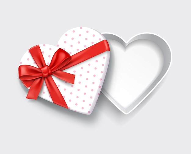 Empty open heart shaped white gift box with red ribbon. Premium Vector