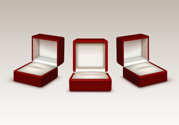 Empty red and white velvet opened gift jewelry boxes Premium Vector