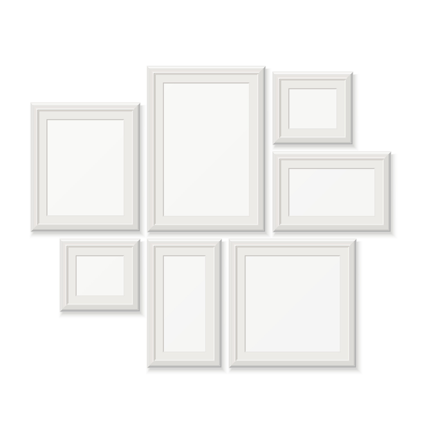 Empty white picture frames, 3d photo borders isolated on white wall. set of frames for photo Premium Vector