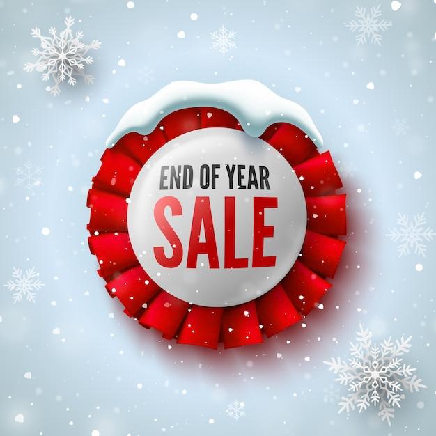 赤いリボン、スノーキャップ、雪片が付いた年末セールのバナー。丸いバッジ。 Premiumベクター