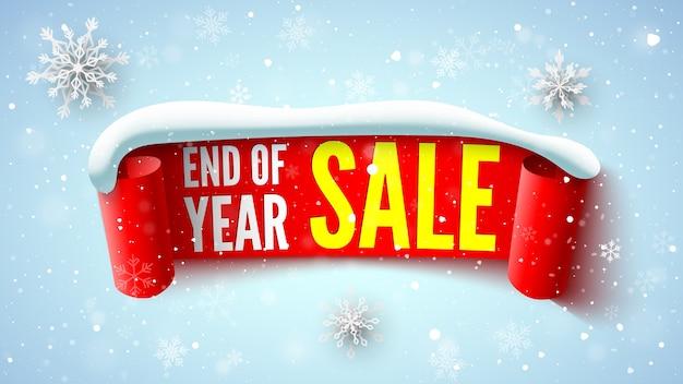 赤いリボンの雪のキャップと雪片の年末セールバナー Premiumベクター