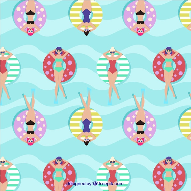 Enjoyable pattern with relaxed women in the sea\ with floats