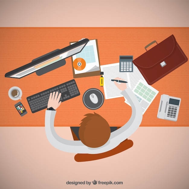 Entrepreneur working on his computer Free Vector