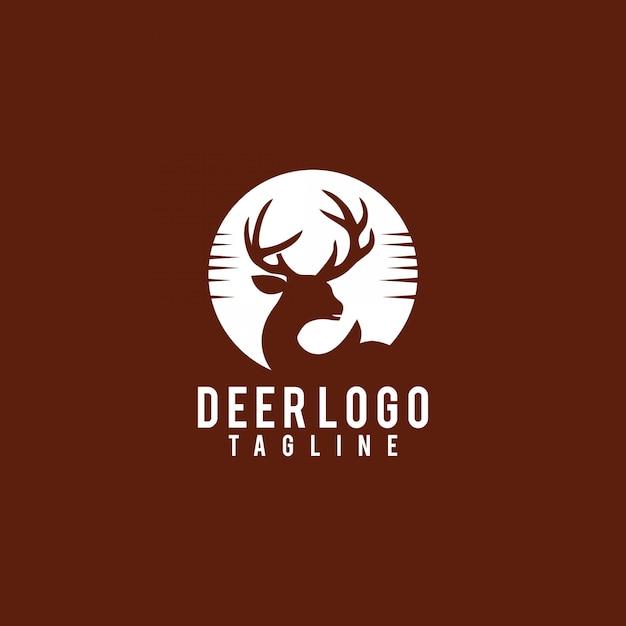 Экзотический закат олень силуэт логотипа дизайн вектор Premium векторы