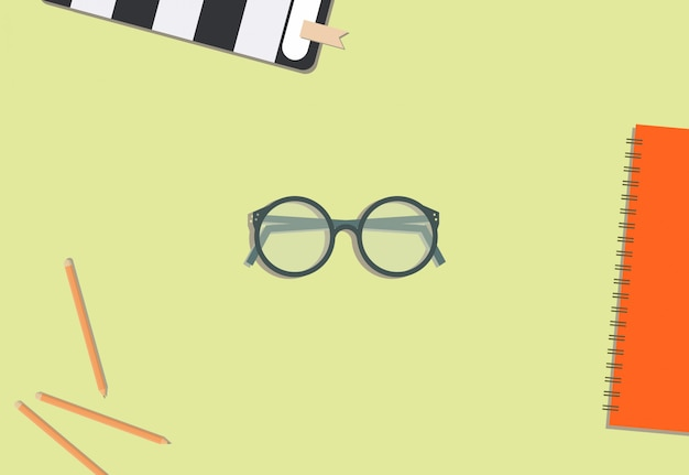 Eyeglasses pencil and book with cream background Premium Vector