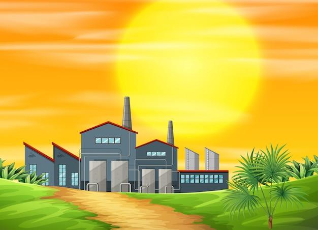 A factory ay rural scene Free Vector