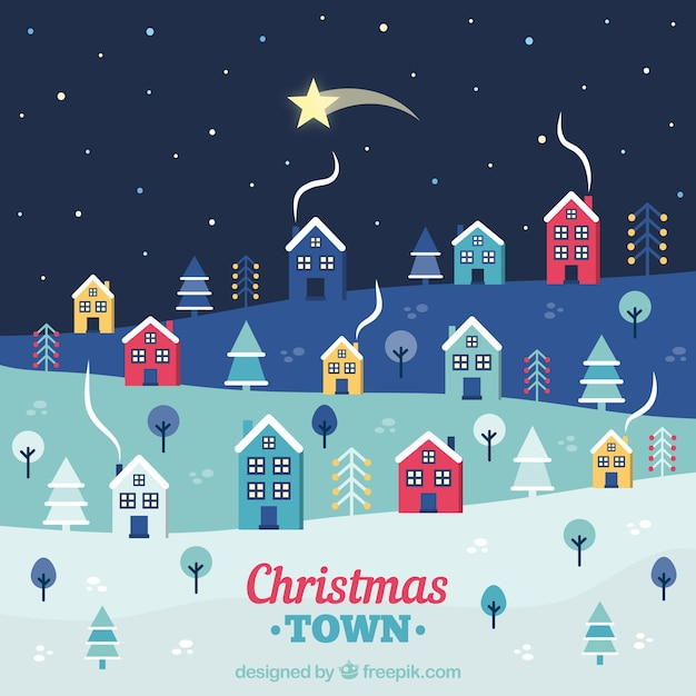 Falling star over a christmas town Free Vector