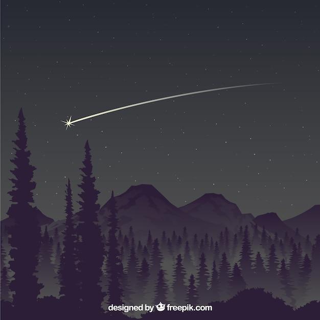 Падающая звезда над горами Premium векторы