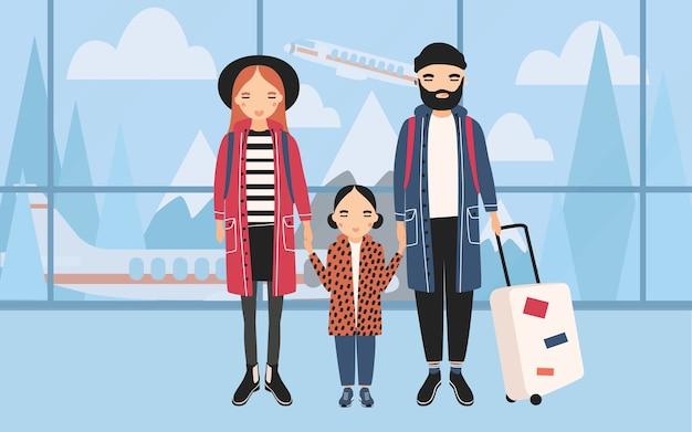 空港での家族。赤ちゃんと荷物とトレンディな若いカップル。 Premiumベクター