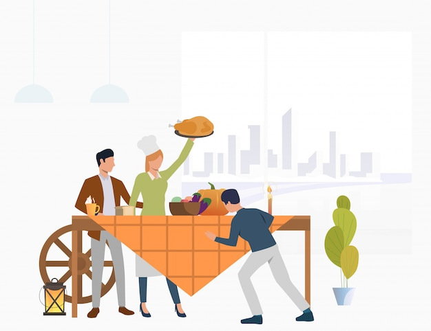 Family gathered at feast table Free Vector