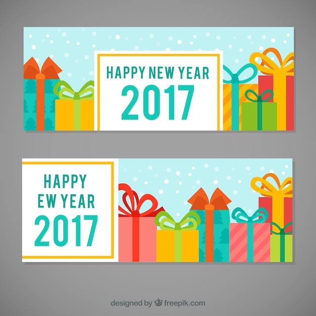 Fantastic new year banners with colorful gifts\ and snow