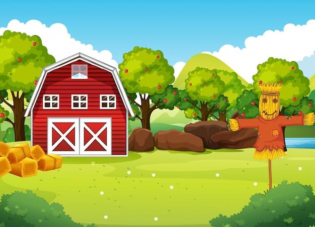 納屋とかかしと自然の中の農場のシーン 無料ベクター