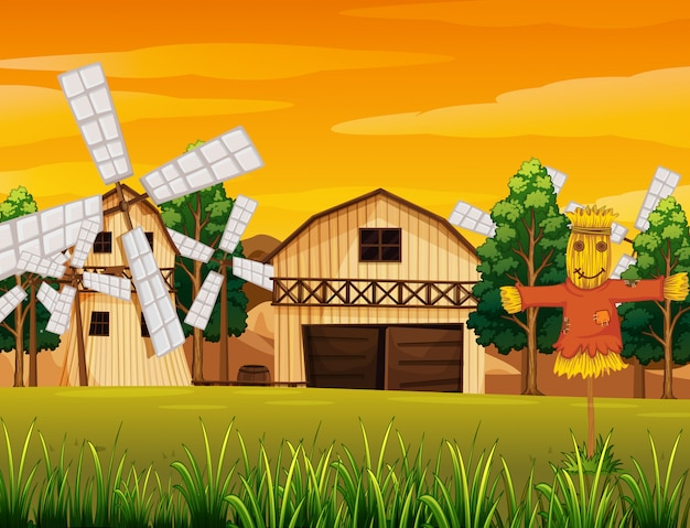 Farm scene in nature with barn and windmill and scarecrow Premium Vector