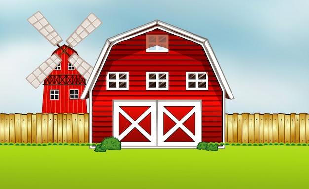Farm scene in nature with barn and windmill Premium Vector