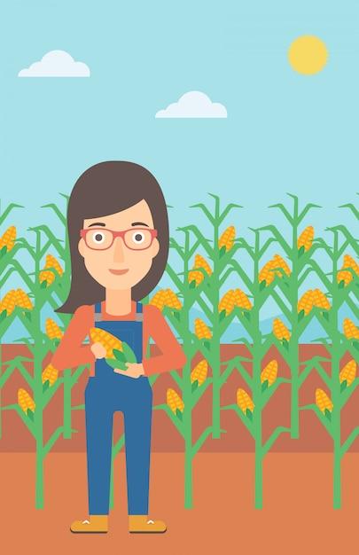 Farmer holding corn Premium Vector