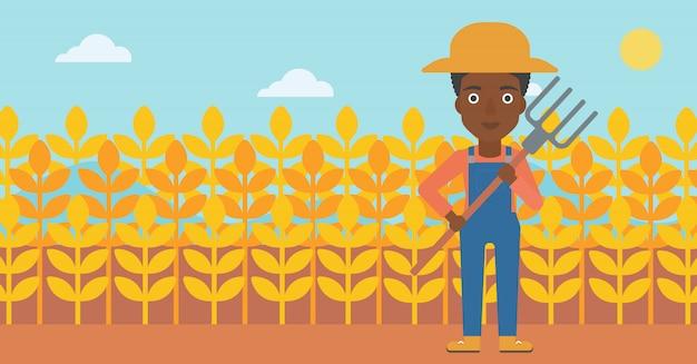 Farmer with pitchfork Premium Vector