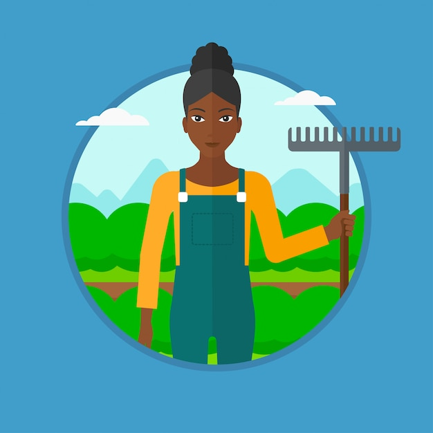 Farmer with rake at cabbage field. Premium Vector