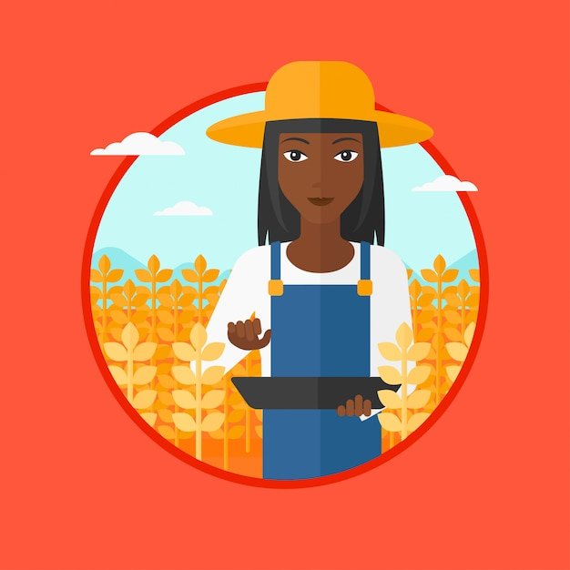 Farmer with tablet computer on field. Premium Vector