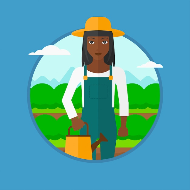 Farmer with watering can at cabbage field. Premium Vector