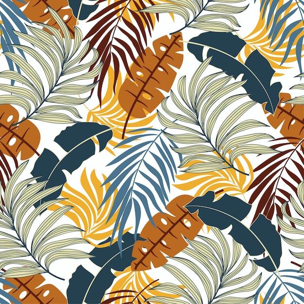 Модный тропический бесшовный узор с красивыми оранжевыми и синими листьями и растениями Premium векторы