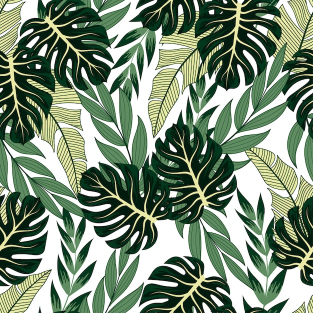 Модный бесшовный тропический узор с яркими растениями и листьями на пастели. Premium векторы