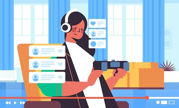 女性ブロガーレコーディングゲームプロセスオンラインブログライブストリーミングブログvlog人気コンセプト女の子ビデオゲームリビングルームインテリア水平肖像画 Premiumベクター