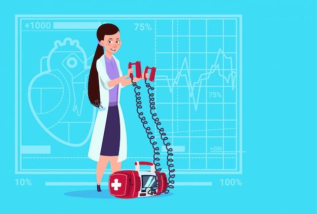 Female doctor hold defibrillator medical clinics worker reanimation hospital Premium Vector