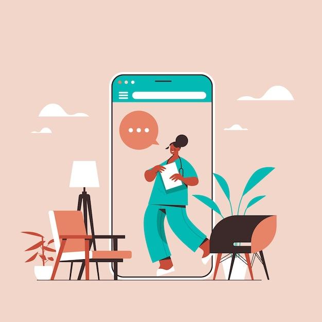 スマートフォン画面の女性医師チャットバブル通信オンライン相談医療医学医療アドバイスコンセプト Premiumベクター