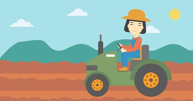 Female farmer driving tractor Premium Vector