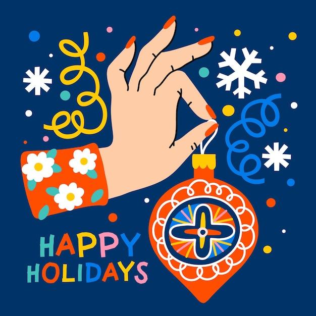クリスマスツリーの装飾を持っている女性の手 Premiumベクター