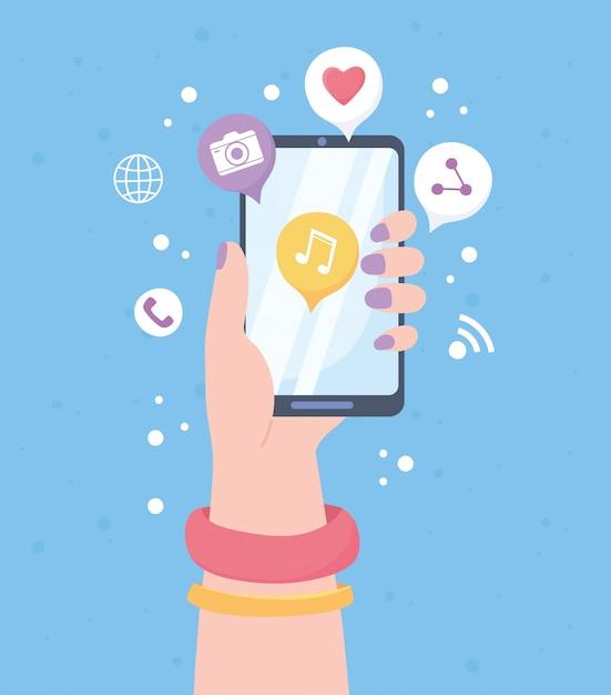 モバイル音楽アプリケーションのソーシャルネットワーク通信システムと技術を持つ女性の手 Premiumベクター