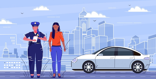 Female police officer writing report parking fine or speeding ticket for sad african american woman driver road traffic safety regulations concept flat full length cityscape Premium Vector