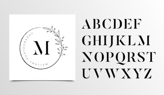 Feminine floral letters logo design template Premium Vector