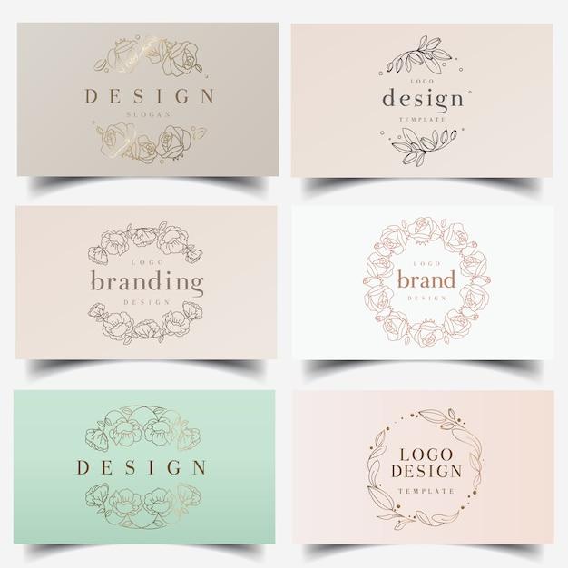 Feminine floral wreath logos Premium Vector